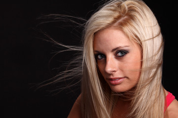 Wind blown Blond Young Woman