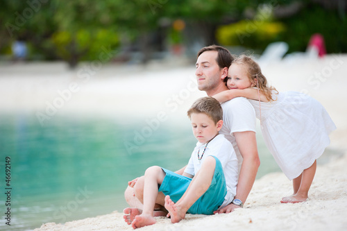 Father and kids on a beach