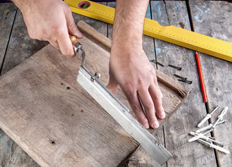 Carpenter working on a hand saw