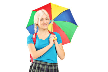 A female student holding an umbrella