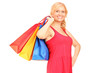 A mature woman holding shopping bags