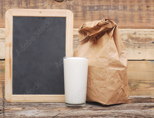 school lunch over blank chalk board