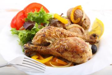 dish of roasted chicken legs