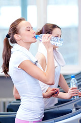 Women drinking water after sports