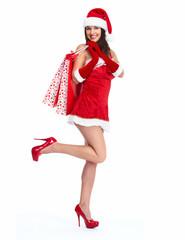 Santa helper Christmas girl with shopping bags.