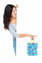 Beautiful shopping Christmas woman with bag.