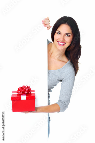 Beautiful young Christmas girl with a present.