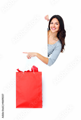Beautiful shopping Christmas woman with bag.