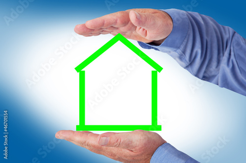 house hold symbolically in hand