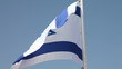 Israel flag waving in wind against clear blue sky