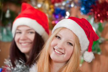 Happy girls in Christmas hats