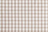 Beige checkered fabric. Tablecloth texture