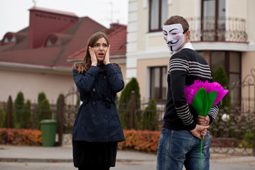 hacker in masked and frightened woman