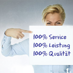 Woman shows: 100% service, performance and quality