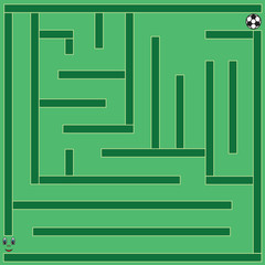 Labyrinth with football player and ball on green field