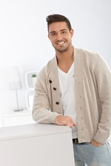 Casual man smiling at home