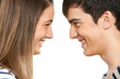 Teen couple facing each other smiling.