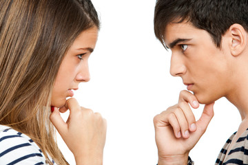 Teen coupe looking at each other wondering.