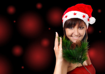 Charming young woman in santa cap