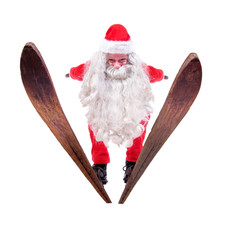 Santa Claus flies on skis
