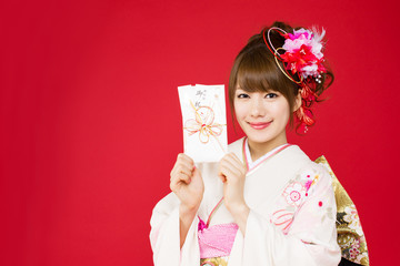 Beautiful japanese kimono woman on red background