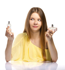 fashion young woman choicing a perfume on white background