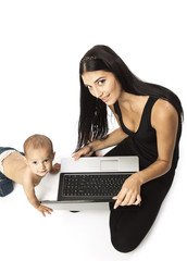Young beautiful woman with a laptop and her little son