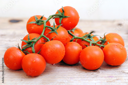 Tomatoes on white wood rustic background