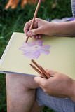 Girl draws flowers with pastels