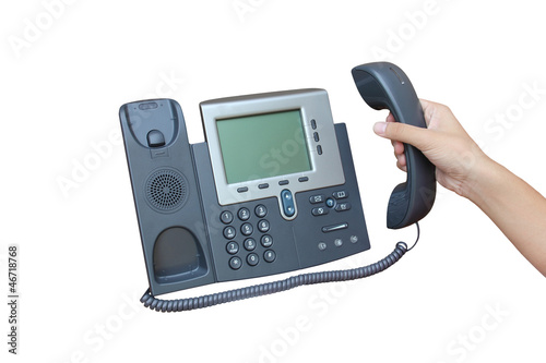 Holding IP phone isolated over white backgroud