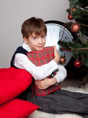 Happy child hugs Christmas gift