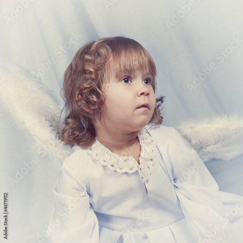 Thoughtful pretty girl with wings, christmas