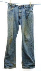 Muddy jeans on a clothesline