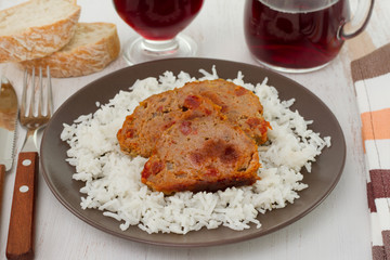 meat with boiled rice and glass of red wine