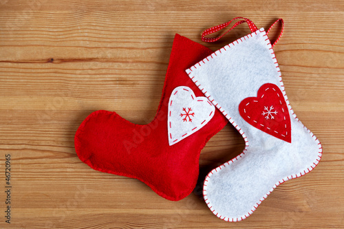 Christmas stockings on wooden background.