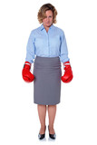 Businesswoman wearing boxing gloves