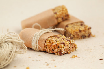 Granola bar or flapjacks on baking paper with hemp string