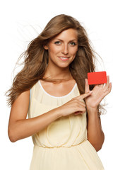 Woman holding empty credit card and pointing at it