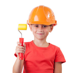 Girl in the construction helmet and a paint roller
