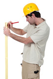 Man marking wood