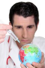 Doctor immunizing the world