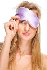 Portrait of woman wearing a sleeping mask