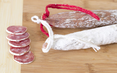 Culinary traditional spanish sausages on wooden background.