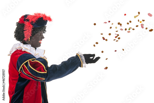 Dutch black pete throwing Sinterklaas candy