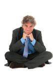 Critical manager sitting on floor poster
