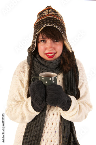 Winter girl drinking hot chocolate