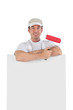 Male decorator stood with blank poster