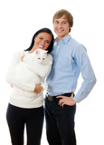 Happy loving couple with cat. Isolated on white.