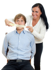 Woman applying tape on man's mouth. Isolated on white.