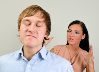 Young couple quarreling. Man in a rage